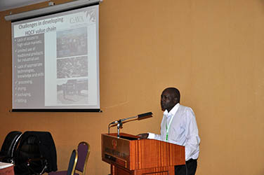 Francis Alacho, Uganda Country Manager, presenting during the C:AVA session of the Global Cassava Partnership meeting in Uganda.